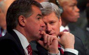 Former environment minister Jim Prentice confers with Prime Minister Stephen Harper.