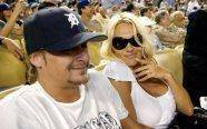 Pamela Anderson and Kid Rock take in a Dodgers game in Dugout Club seats.