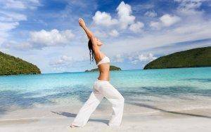 What better way to enjoy healthy living than practicing yoga on the beach?