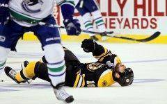 Nathan Horton lies prone on the ice following a hit by Vancouver's Aaron Rome.